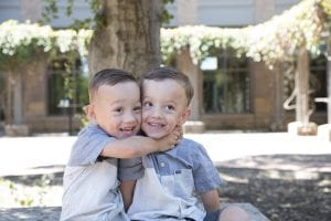 Twin brothers Brantley and Braxton Headrick hug one another in the courtyard outside the UC Davis MIND Institute.
